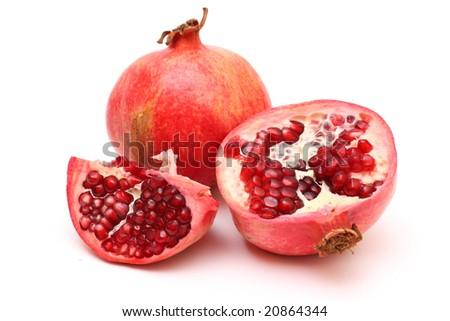 Fresh appetizing pomegranates on white background - stock photo