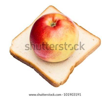 fresh apple and toast on white - stock photo