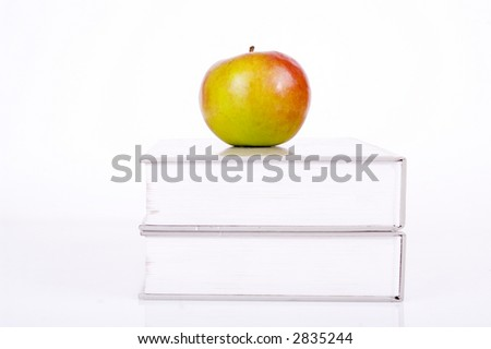 fresh apple on a book