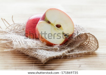 Fresh apple on a wood board - stock photo
