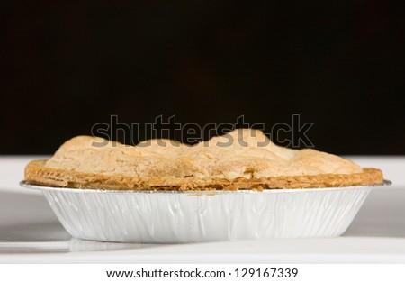Fresh apple pie in tin - stock photo