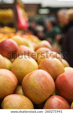 Fresh apples at marketplace. Shallow depth of field. - stock photo