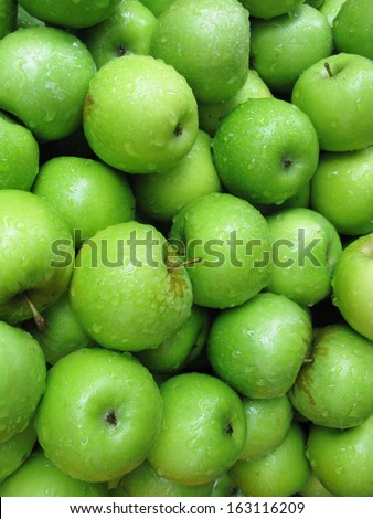 Fresh apples at the greengrocer on the market place - stock photo