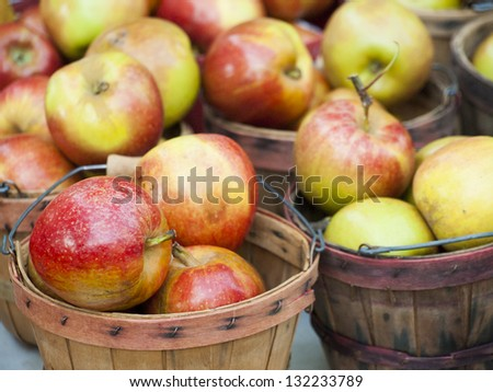 Fresh apples at the local farmers market. Farmers markets are a traditional way of selling agricultural products.
