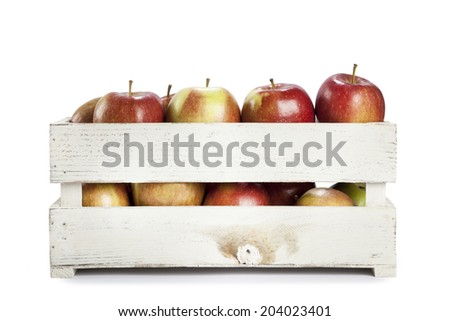 Fresh apples in a wooden crate on white background - stock photo