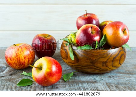 Fresh apples in the wooden bowl. Ripe fruits as healthy eating or vegetarian food concept.  - stock photo