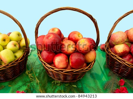 Fresh apples in wicker baskets. Clipping path included.