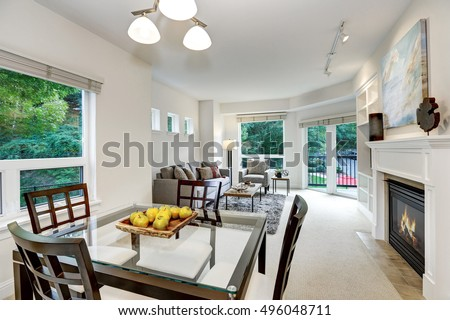 Fresh apples on modern dining table . Open floor plan. Apartment interior. Northwest, USA