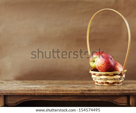 Fresh apples on wooden table - stock photo