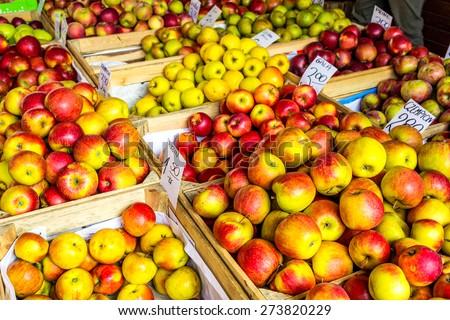 Fresh apples stand at the city market, Krakow, Poland - stock photo