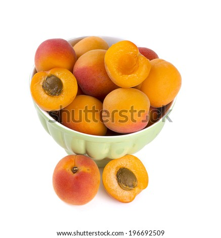 fresh apricots in a bowl over white - stock photo