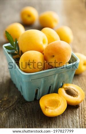 Fresh apricots on desk - stock photo