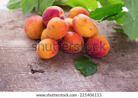 Fresh apricots on  wooden background. Selective focus, horizontal. - stock photo