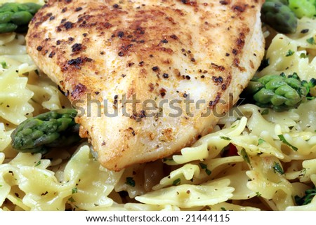 Fresh aromatic pasta with chicken breast made with organic vegetables and organic chicken