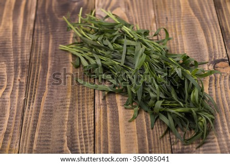 Fresh aromatic twigs of eating pot-herb herbal organic ingredients seasoning cooking healthy lifestyle on wooden background closeup studio, horizontal picture - stock photo