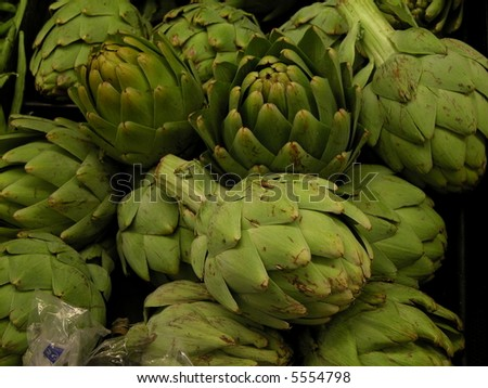 fresh artichokes at a grocery store - stock photo