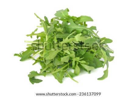 fresh arugula leaves isolated on white - stock photo