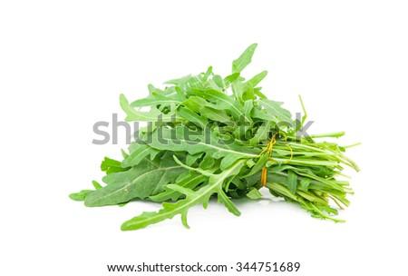 fresh arugula leaves on white background - stock photo