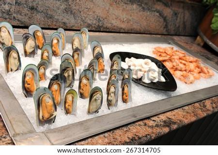 Fresh Asian green mussel in buffet line - stock photo