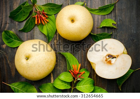 Fresh asian pear (tropical fruit) on wooden background - stock photo