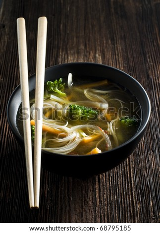 Fresh asian vegetable soup with noodles close up - stock photo
