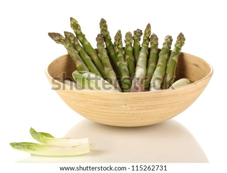 Fresh asparagus in wooden bowl isolated on white - stock photo