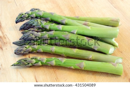Fresh asparagus on cutting board in horizontal format - stock photo
