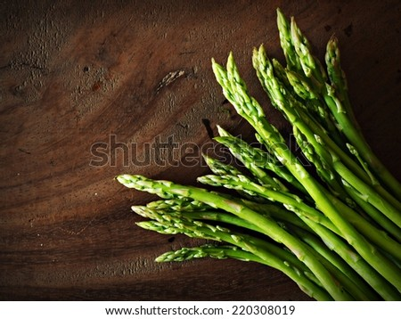 Fresh Asparagus  on the wood background - stock photo