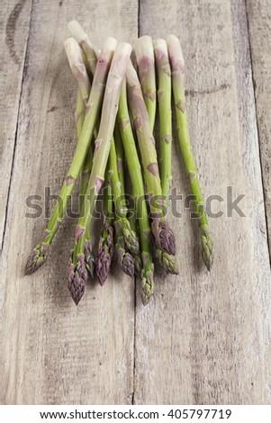 fresh asparagus on wood background - stock photo