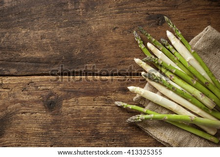 Fresh asparagus on wooden background overhead shoot - stock photo