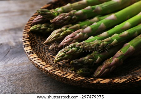 Fresh asparagus on wooden table, closeup - stock photo
