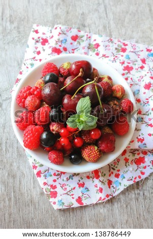Fresh assorted berries in a plate - stock photo