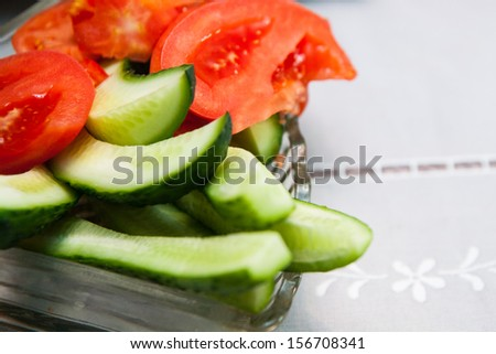 Fresh assorted green salad with cucumbers and tomatoes. - stock photo