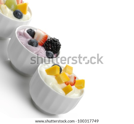 Fresh Assorted Yogurts With Fruits And Berries - stock photo