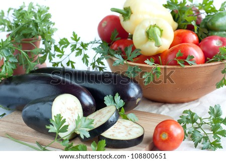 Fresh aubergines, whole and sliced, fresh vegetables