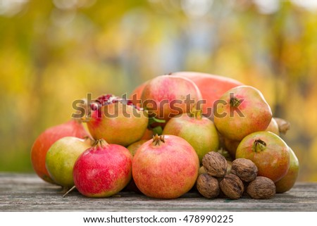 Fresh autumn fruits,on a wooden table