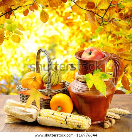 Fresh autumn vegetables on golden forest background