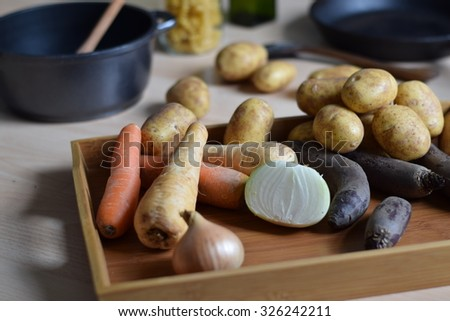 Fresh autumn vegetables on the wooden table are ready to be chopped and cooked as ingredients for delicious soup