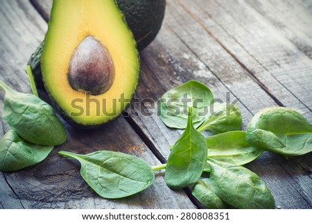 fresh  avocado and baby spinach - stock photo