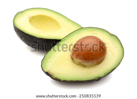 fresh avocado cut in half isolated on white - stock photo