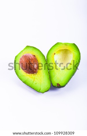 Fresh avocado fruit isolated over white background - stock photo
