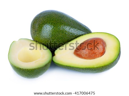 Fresh avocado fruits cit in half isolated on white background - stock photo
