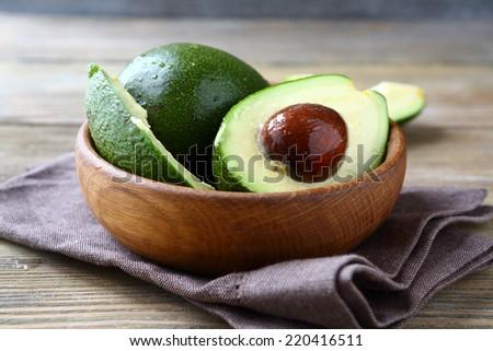 Fresh avocado in a bowl, fruit - stock photo