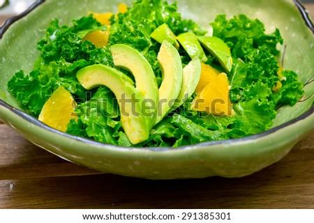 fresh avocado salad with orange pulp and feta cheese - stock photo