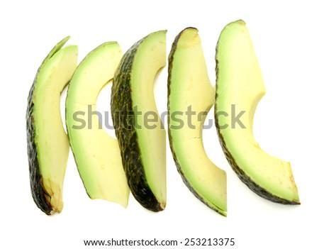 fresh avocado sliced on white background - stock photo