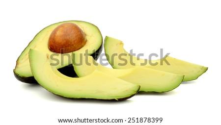 fresh avocado slices isolated on white - stock photo