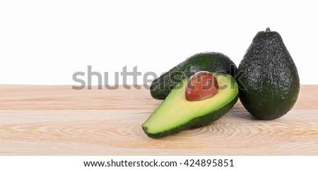 Fresh avocados on a white background - stock photo