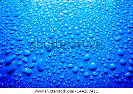 fresh background of water drops on blue background - stock photo