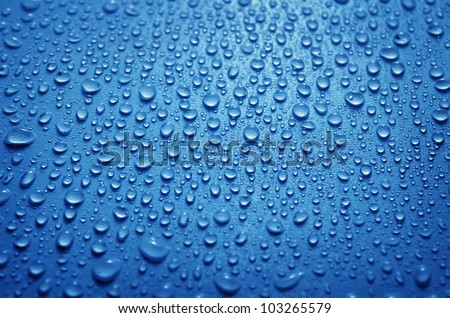 fresh background of water drops on blue surface - stock photo