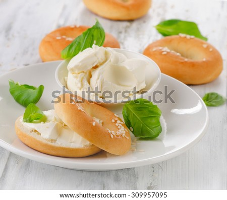 Fresh bagels with cream cheese for a healthy breakfast. Selective focus - stock photo